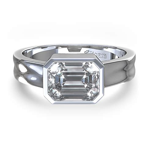bezel set emerald cut ring in 14k white gold