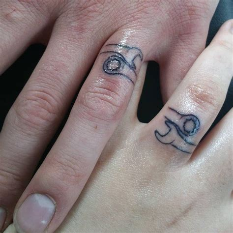 tattoo name wedding bands his and hers wedding ring tattoos wedding rings