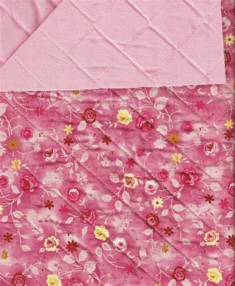 pink and yellow floral on pink reversible pre quilted
