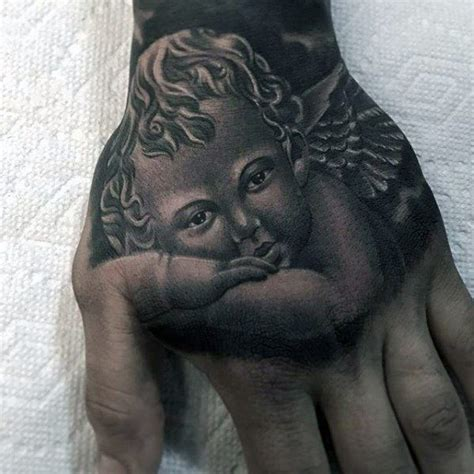 tattoo angel on hand 60 tattoo cover up ideas for men before and after designs