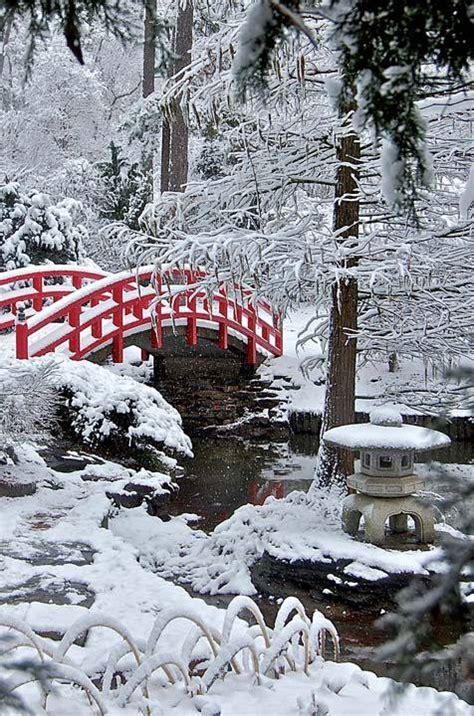 the garden in winter bridge in snow garden photo of the day jan johnsen