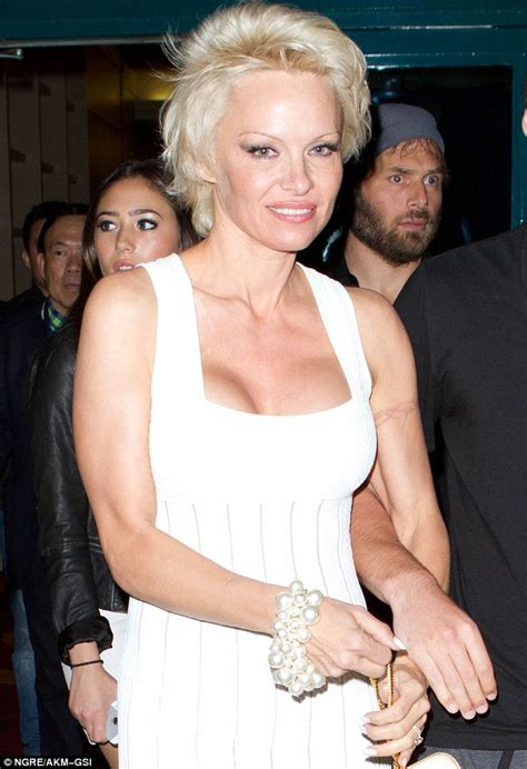 pamela anderson removing her barbed wire tattoo with laser
