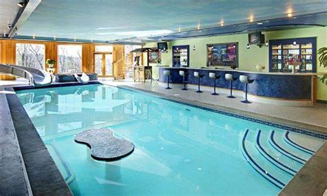 fascinating indoor swimming pool using pool with bar