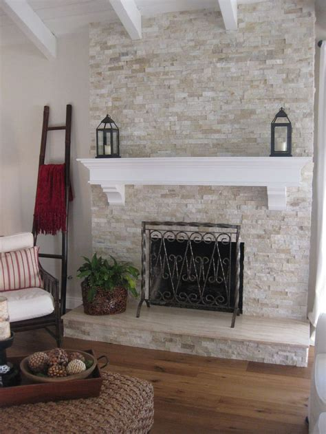pin refacing a brick fireplace with marble tile on