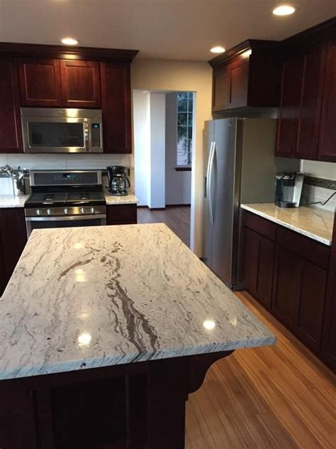 cherry cabinets with granite countertops new kitchen with dark cherry cabinets wine river granite