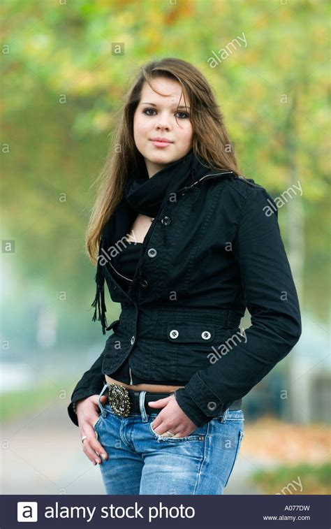 16 in years 16 year with brown hair outside in autumn stock photo royalty free image