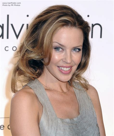 rolling hair styles kylie minogue s long hairstyle with rolling volume