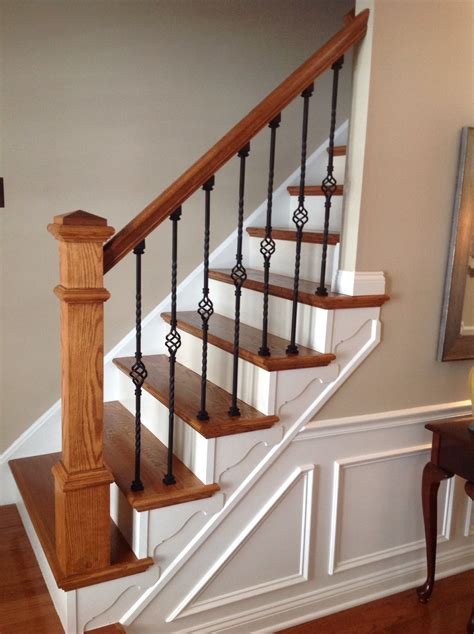 stairway  railing wainscoting wrought iron balusters sw pavilion beige paint
