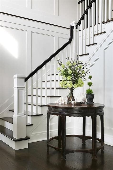 Marianne Banister Chic Foyer Opens To A Staircase Fitted With White Spindles