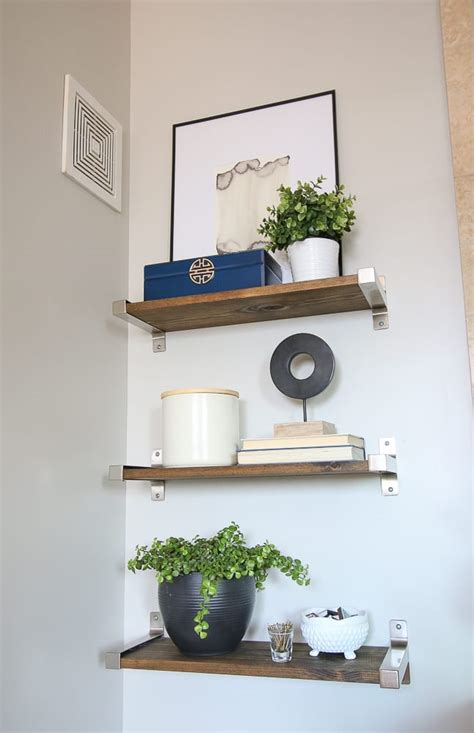 how to decorate bathroom shelves above the toilet