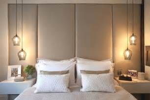 Use pendant lights on either side of your bed who said you have to