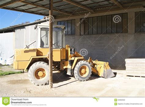 Machine Truck Construction Limited bulldozer construction vehicle in a store factory or a warehouse stock photo image of bags