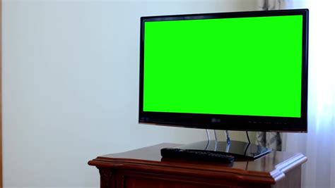 green tv couple sitting in front of blank green tv screen stock