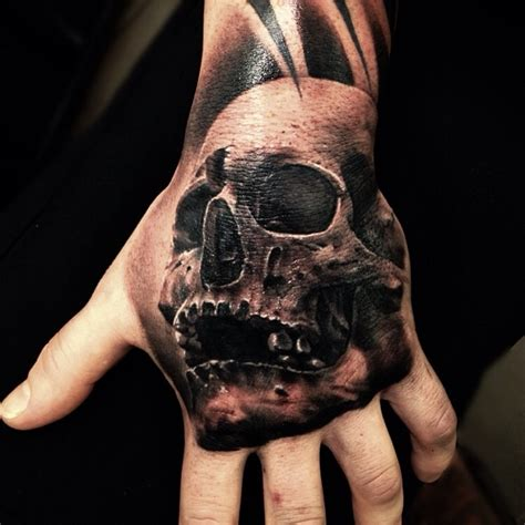 tattoo ideas skulls skull hand tattoos designs ideas and meaning tattoos