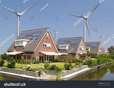 new family homes with solar panels and wind turbines stock