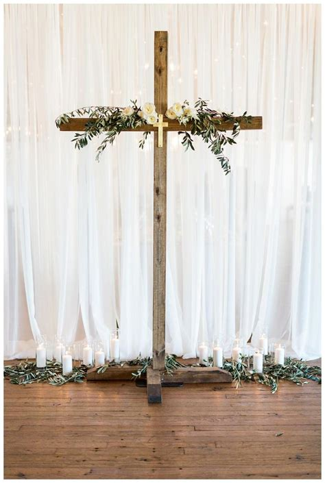 wedding ceremony for wedding ceremony decor with a wooden cross olive branches