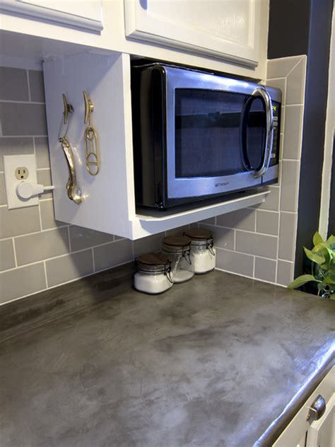 hang microwave under cabinet how to hang a microwave a cabinet an installed microwave
