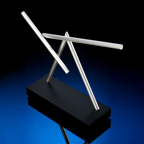 the swinging sticks the swinging sticks kinetic desk sculpture the green head