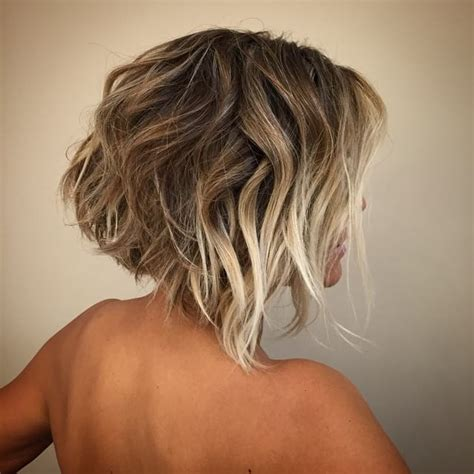 angled bob with waves for 40 year old woman women s short angled bob with blonde balayage color and