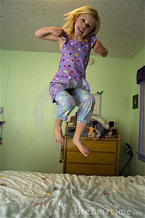 angry girl jumping   bed royalty  stock
