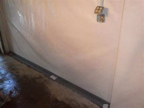 removing water from basement cleanspace wall system installed