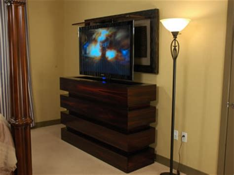 55 inch tv in bedroom rises out of le bloc