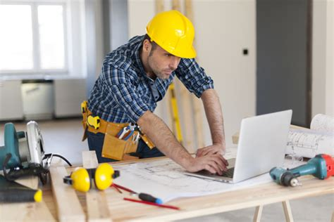 Free To Find Information On Workers Using Tablet To Find Information Stock Photo 02 Construction Stock Photo