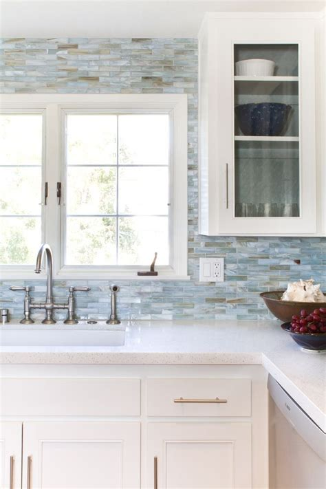 blue grey kitchen backsplash with white countertops