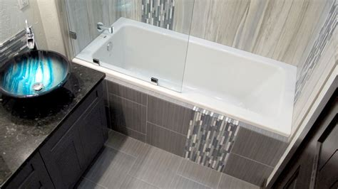 Combined Bath And Shower large custom home with porcelain tile and natural stone