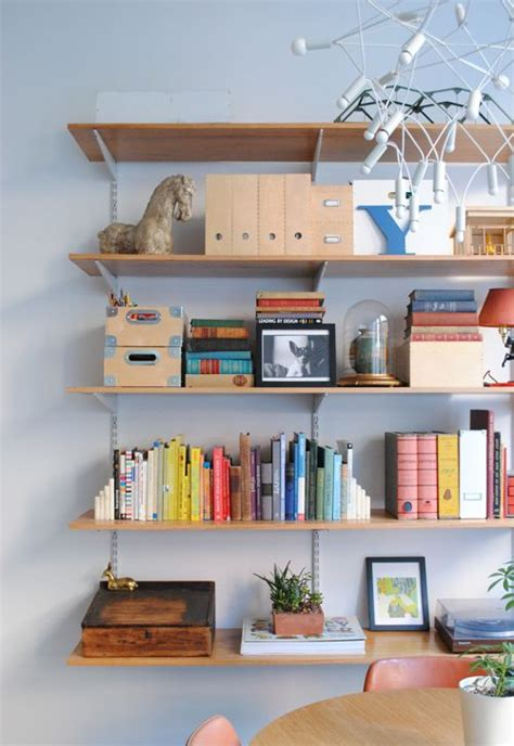 objects in space books styling a bookshelf 10 homes that get it right 5 tips