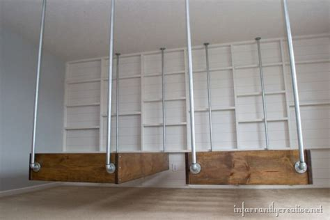 industrial wood and pipe hanging beds