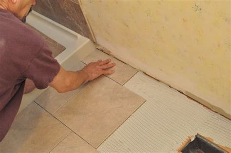 how to tile a bathroom floor around a toilet how to tile a bathroom floor diy around the house pinterest