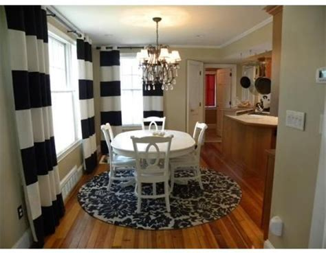 round rugs for dining room round rug under dining room table love this look