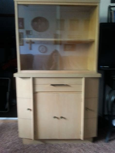 china cabinet with sliding glass doors i have a blonde china cabinet sliding glass doors on top a