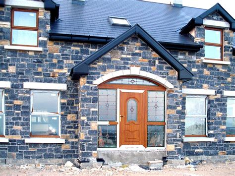 Front of house with traditional stonework finish by Pat
