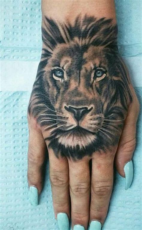 lion tattoo on your finger lion hand tattoo tattoos pinterest l 246 win tattoo