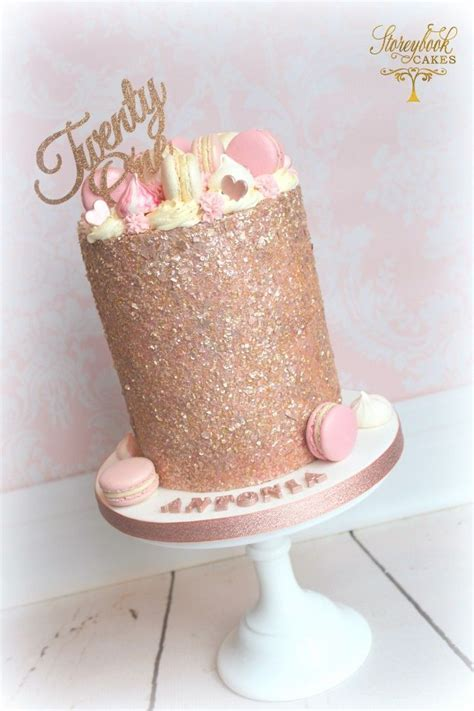 Tall rose gold glittery birthday cake with macarons