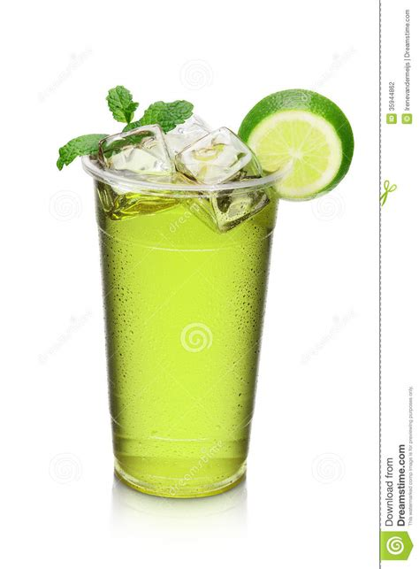 green cocktail green cocktail drink with lime slice and mint stock photo