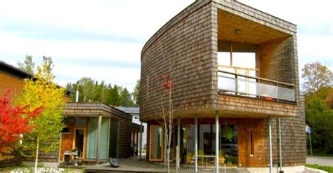 home design nj espoo spiraling green roofed espoo house clad in siberian larch