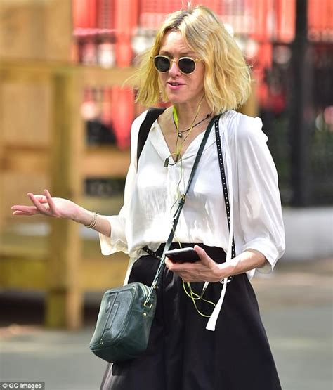 Watts Blouse watts wears white blouse and black midi skirt while