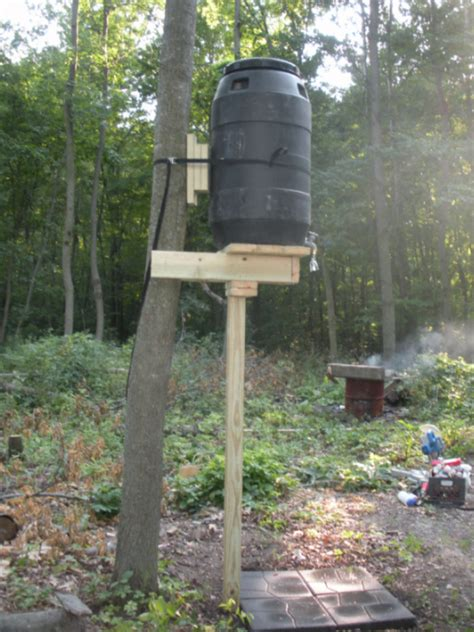 grid shower in the woods use a barrel to store the