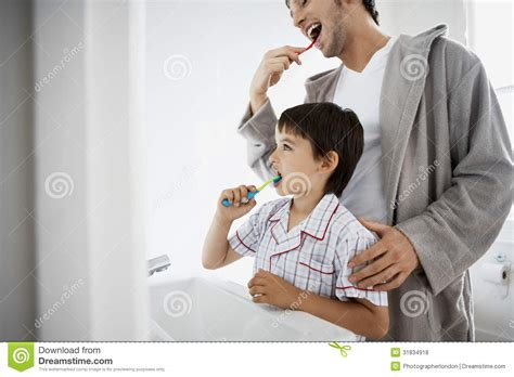 son in bathroom father and son brushing teeth royalty free stock photos