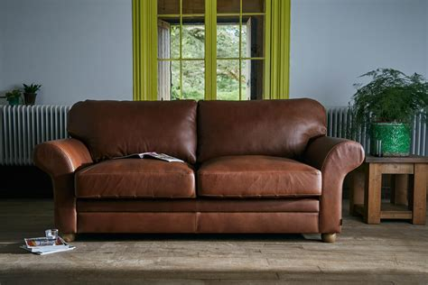 the curved arm brown leather sofa by indigo furniture