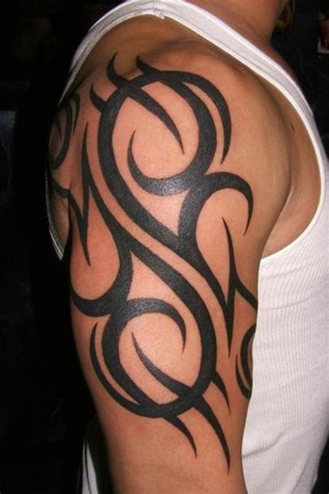 tribal arm tattoo picture for men tattooshunt com