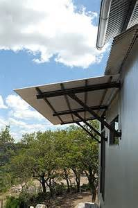 sheet metal awning corrugated metal awning lake flato backyard