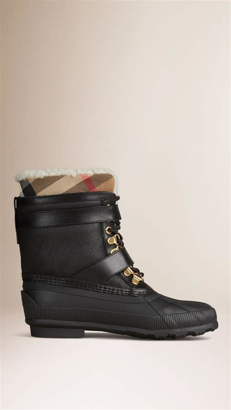 black duck boots burberry shearling lined sueded duck boots in black lyst