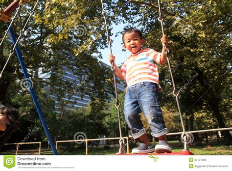 japan swing japanese boy on a swing stock photo image of person