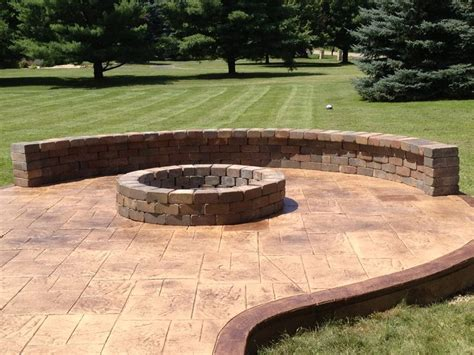 sted concrete patio with pit and sitting wall