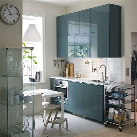 a small modern kitchen with white walls and high gloss