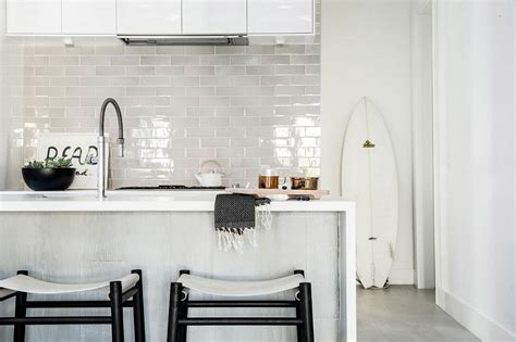 kitchen backdrops nordic influence posh bachelor pad moves away from leather and dark finishes